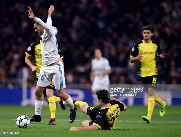 Real Madrid's Spanish midfielder Daniel Ceballos vies with Dortmund's Greek defender Sokratis during the UEFA Champions League group H football match...