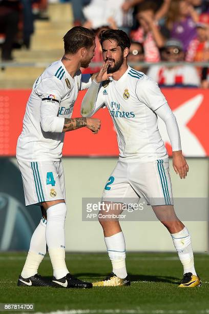 Real Madrid's Spanish midfielder Isco celebrates a goal with Real Madrid's Spanish defender Sergio Ramos during the Spanish league football match...