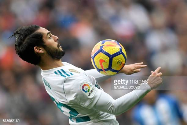 Real Madrid's Spanish midfielder Isco controls the ball at the Santiago Bernabeu stadium in Madrid during the Spanish league football match Real...