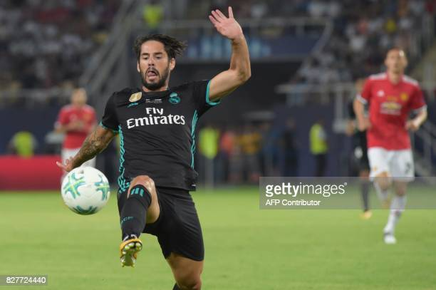 Real Madrid's Spanish midfielder Isco controls the ball during the UEFA Super Cup football match between Real Madrid and Manchester United on August...