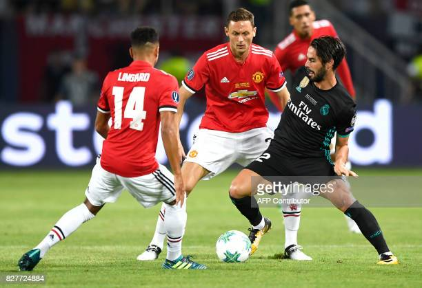 Real Madrid's Spanish midfielder Isco drives the ball next to Manchester United's Serbian midfielder Nemanja Matic during the UEFA Super Cup football...