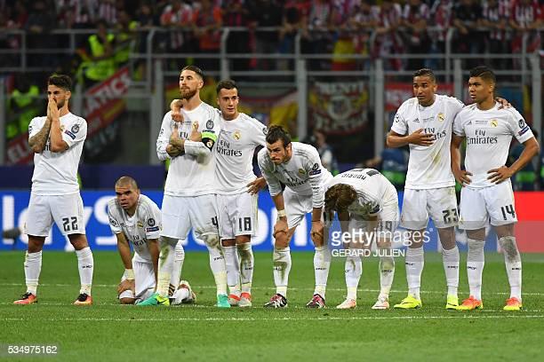 Real Madrid's Spanish midfielder Isco Real Madrid's Portuguese defender Pepe Real Madrid's Spanish defender Sergio Ramos Real Madrid's Spanish...