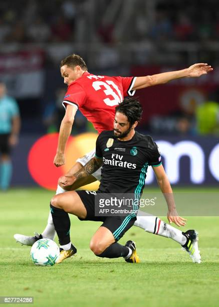 Real Madrid's Spanish midfielder Isco vies with Manchester United's Serbian midfielder Nemanja Matic during the UEFA Super Cup football match between...