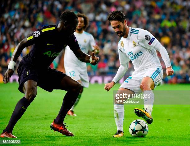 Real Madrid's Spanish midfielder Isco vies with Tottenham Hotspur's Colombian defender Davinson Sanchez during the UEFA Champions League group H...
