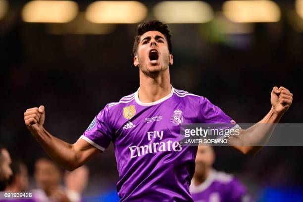 TOPSHOT Real Madrid's Spanish midfielder Marco Asensio celebrates after scoring their fourth goal during the UEFA Champions League final football...