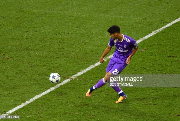 Real Madrid's Spanish midfielder Marco Asensio scores a goal during the UEFA Champions League final football match between Juventus and Real Madrid...