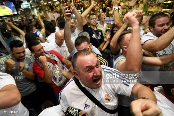 Real Madrid's supporters elebrates a goal by Real Madrid's Brazilian midfielder Casemiro as they watch play from a bar in Madrid on June 3 2017...