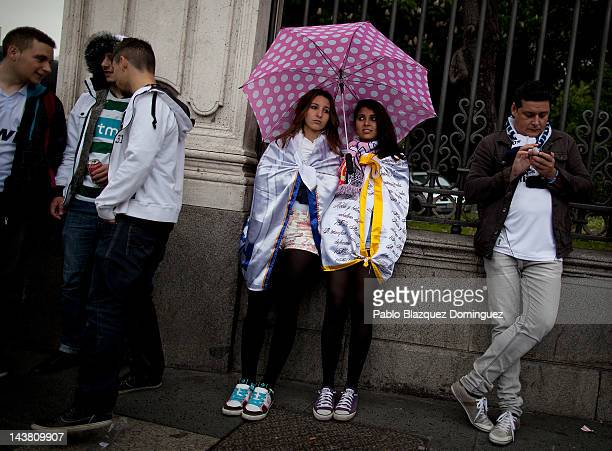 Real Madrid's supporters wait for their team on a rainy day to celebrate at Cibeles Square on May 3 in Madrid Spain Real Madrid are celebrating...