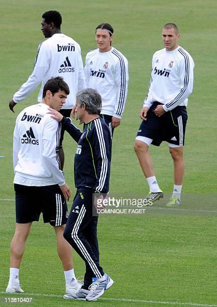 Real Madrid's Togolese forward Emmanuel Adebayor Real Madrid's German midfielder Mesut Ozil Real Madrid's French forward Karim Benzema Real Madrid's...