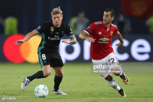 Real Madrid's Toni Kroos and Manchester United's Henrikh Mkhitaryan battle for the ball during the UEFA Super Cup match at the Philip II Arena Skopje...