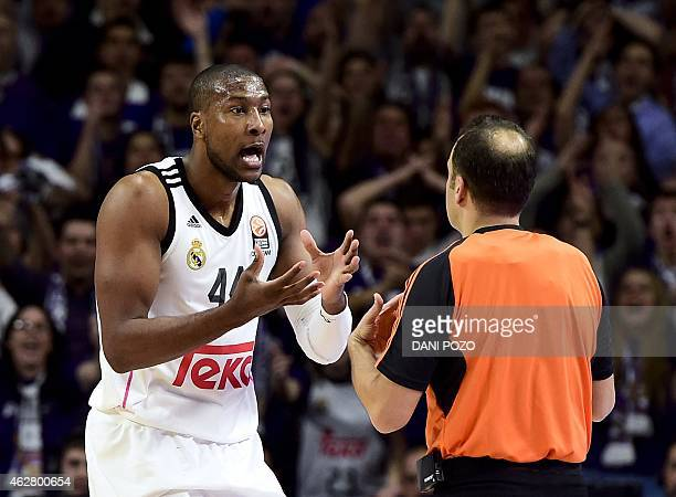 Real Madrid's US forward Marcus Slaughter argues with referee during the Euroleague basketball Top 16 round 6 match Real Madrid vs FC Barcelona at...