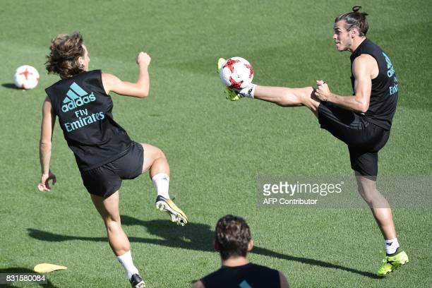 Real Madrid's Welsh forward Gareth Bale and Real Madrid's Croatian midfielder Luka Modric take part in a training session at Real Madrid sport city...