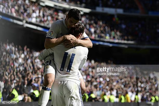 Real Madrid's Welsh forward Gareth Bale and Real Madrid's forward Alvaro Morata celebrate after scoring a goal during the Spanish league football...