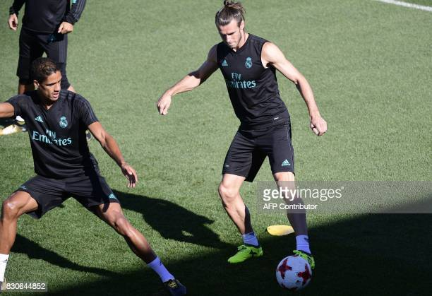 Real Madrid's Welsh forward Gareth Bale and Real Madrid's French defender Raphael Varane take part in a training session at Real Madrid sport city in...