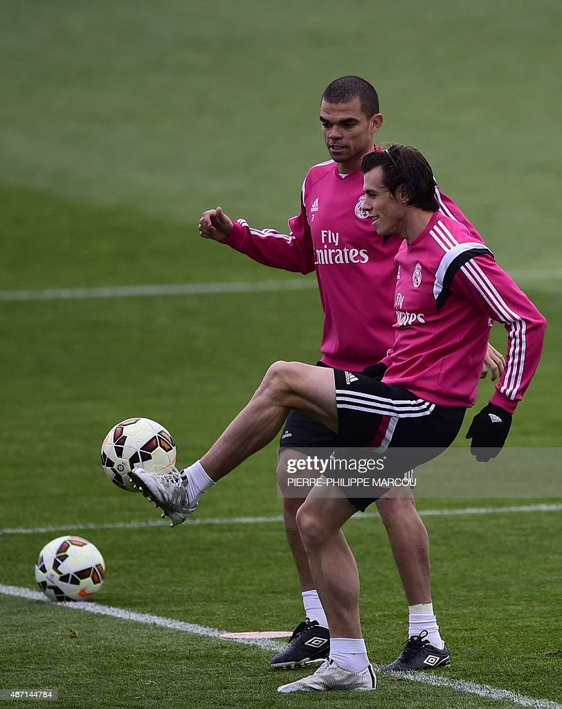 Real Madrid's Welsh forward <a gi-track='captionPersonalityLinkClicked' href=/galleries/search?phrase=Gareth+Bale&family=editorial&specificpeople=609290 ng-click='$event.stopPropagation()'>Gareth Bale</a> (R) and Real Madrid's Portuguese defender <a gi-track='captionPersonalityLinkClicked' href=/galleries/search?phrase=Pepe+-+Portuguese+Soccer+Player&family=editorial&specificpeople=4401229 ng-click='$event.stopPropagation()'>Pepe</a> train at the Valdebebas sport city in Madrid on March 21, 2015 on the eve of their 'clasico' match against Barcelona.