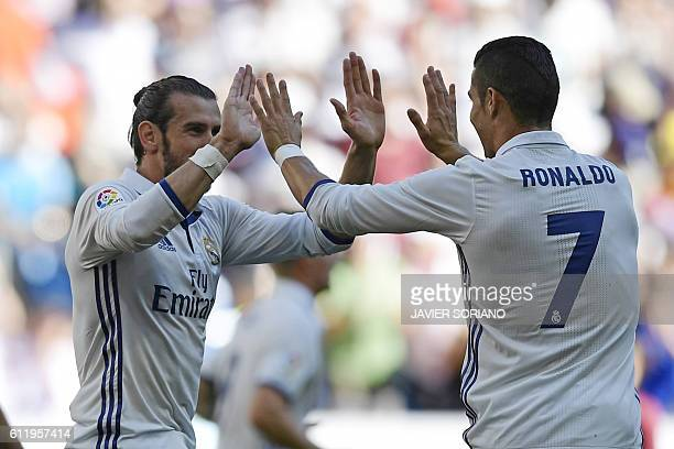 Real Madrid's Welsh forward Gareth Bale and Real Madrid's Portuguese forward Cristiano Ronaldo celebrate after scoring a goal during the Spanish...