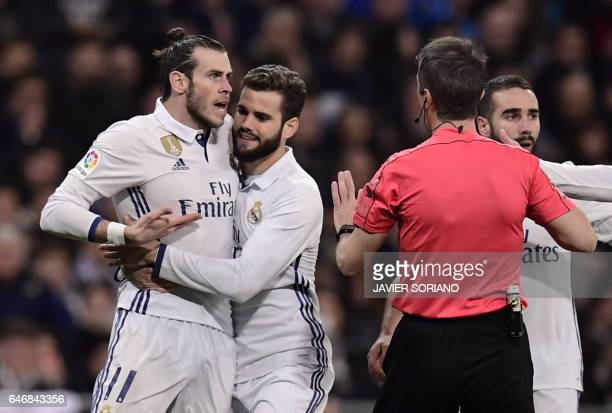 TOPSHOT Real Madrid's Welsh forward Gareth Bale argues with the referee as Real Madrid's defender Nacho Fernandez tries to stop him during the...