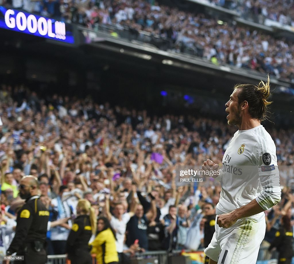 Real Madrid's Welsh forward Gareth Bale celebrates a goal during the UEFA Champions League semi-final second leg football match Real Madrid CF vs Manchester City FC at the Santiago Bernabeu stadium in Madrid, on May 4, 2016. / AFP / PAUL
