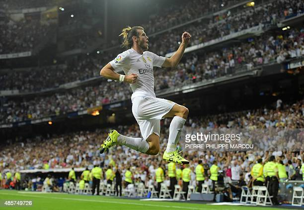 Real Madrid's Welsh forward Gareth Bale celebrates after scoring his second goal during the Spanish league football match Real Madrid CF vs Real...