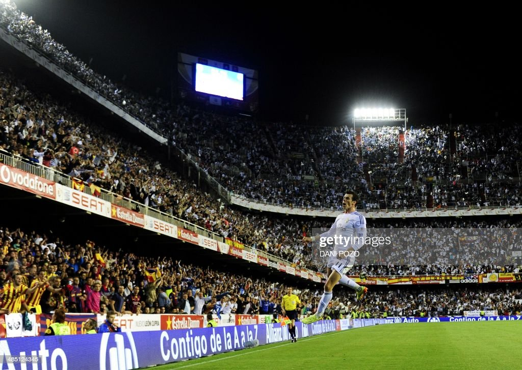 Real Madrid's Welsh forward Gareth Bale celebrates after scoring during the Spanish Copa del Rey final 'Clasico' football match FC Barcelona vs Real...