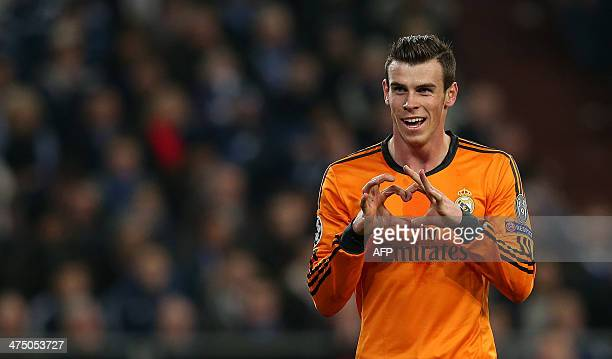 Real Madrid's Welsh forward Gareth Bale celebrates scoring his team's second goal during the firstleg round of 16 UEFA Champions League football...