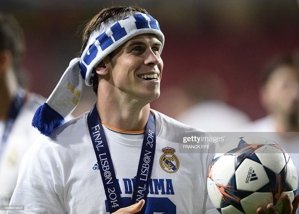 Real Madrid's Welsh forward Gareth Bale celebrates their victory at the end of the UEFA Champions League Final Real Madrid vs Atletico de Madrid at Luz stadium in Lisbon, on May 24, 2014. Real Madrid won 4-1.