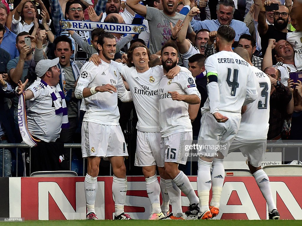 Real Madrid's Welsh forward Gareth Bale celebrates with Real Madrid's Croatian midfielder Luka Modric Real Madrid's defender Dani Carvajaland...