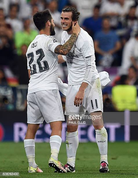 Real Madrid's Welsh forward Gareth Bale celebrates with Real Madrid's midfielder Isco at the end of the UEFA Champions League semifinal second leg...