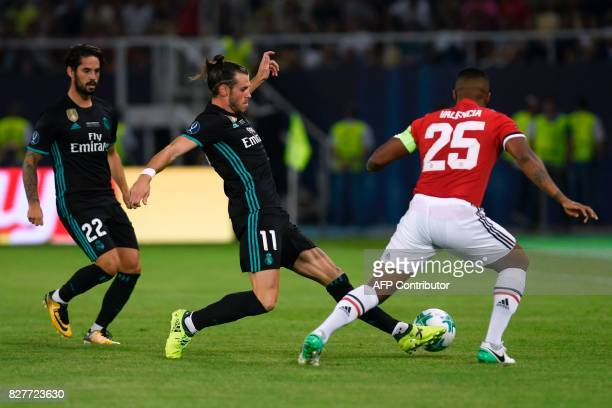 Real Madrid's Welsh forward Gareth Bale drives the ball next to Real Madrid's Spanish midfielder Isco during the UEFA Super Cup football match...