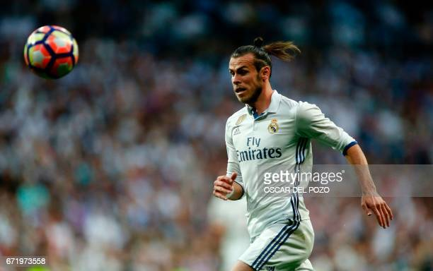 Real Madrid's Welsh forward Gareth Bale goes for the ball during the Spanish league football match Real Madrid CF vs FC Barcelona at the Santiago...
