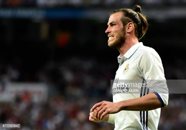 Real Madrid's Welsh forward Gareth Bale grimaces after missing a goal opportunity during the Spanish league Clasico football match Real Madrid CF vs...