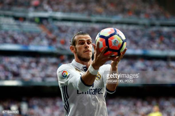 Real Madrid's Welsh forward Gareth Bale holds the ball during the Spanish league football match Real Madrid CF vs FC Barcelona at the Santiago...