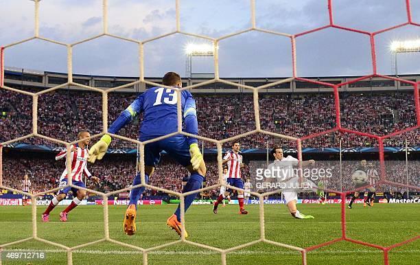 Real Madrid's Welsh forward Gareth Bale kicks a ball against Atletico Madrid's Slovenian goalkeeper Jan Oblak during the UEFA Champions League...