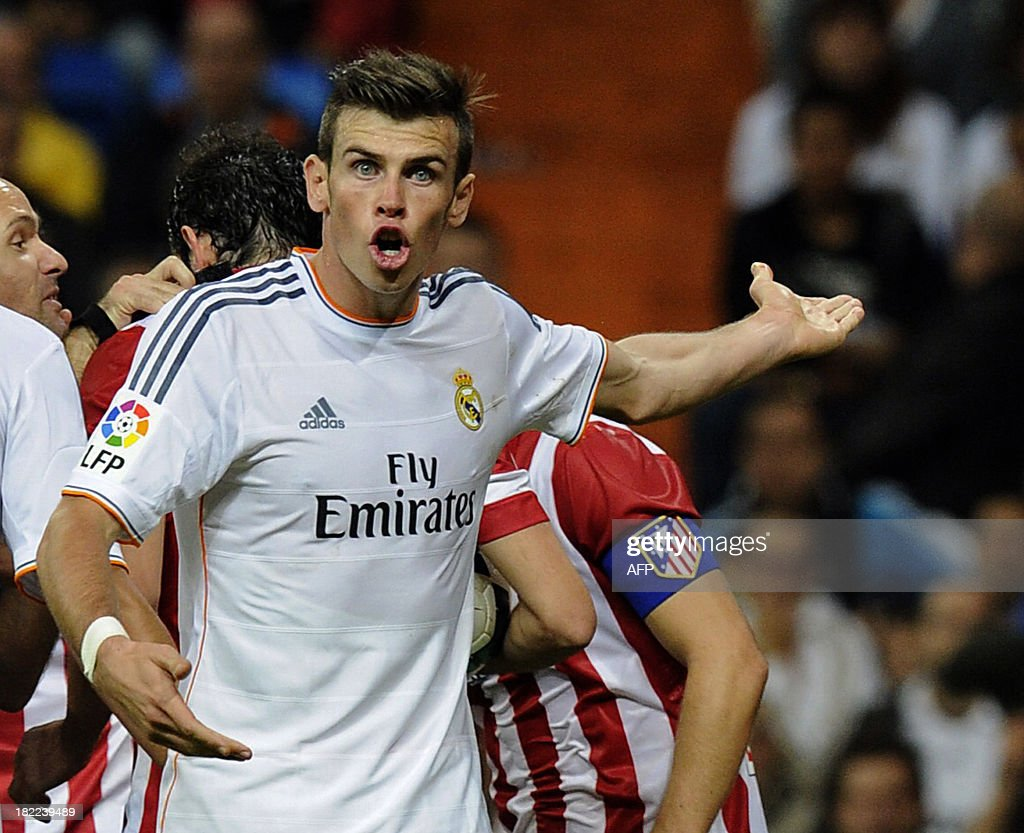 Real Madrid's Welsh forward Gareth Bale reacts during the Spanish league football match Real Madrid CF vs Club Atletico de Madrid at the Santiago Bernabeu stadium in Madrid on September 28, 2013. Atletico won 1-0.