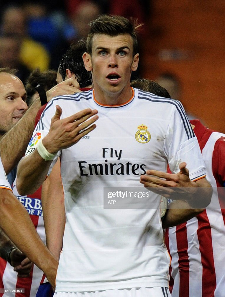 Real Madrid's Welsh forward Gareth Bale reacts during the Spanish league football match Real Madrid CF vs Club Atletico de Madrid at the Santiago Bernabeu stadium in Madrid on September 28, 2013. Atletico won 1-0. AFP PHOTO/ CURTO DE LA TORRE