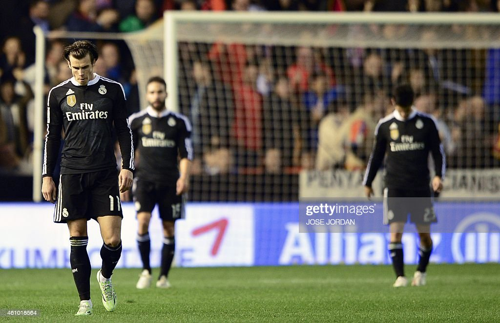 Real Madrid's Welsh forward <a gi-track='captionPersonalityLinkClicked' href=/galleries/search?phrase=Gareth+Bale&family=editorial&specificpeople=609290 ng-click='$event.stopPropagation()'>Gareth Bale</a>, Real Madrid's defender <a gi-track='captionPersonalityLinkClicked' href=/galleries/search?phrase=Dani+Carvajal+-+Spanish+Soccer+Defender&family=editorial&specificpeople=7916431 ng-click='$event.stopPropagation()'>Dani Carvajal</a> and Real Madrid's midfielder <a gi-track='captionPersonalityLinkClicked' href=/galleries/search?phrase=Isco&family=editorial&specificpeople=5848609 ng-click='$event.stopPropagation()'>Isco</a> walk away after a Valencia goal during the Spanish league football match Valencia CF v Real Madrid CF at the Mestalla stadium in Valencia on January 4, 2015.