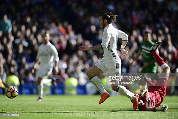 Real Madrid's Welsh forward Gareth Bale scores past Leganes's goalkeeper Serantes during the Spanish league football match Real Madrid CF vs Club...
