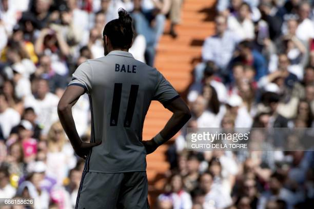 Real Madrid's Welsh forward Gareth Bale stands during the Spanish league football match Real Madrid CF vs Club Atletico de Madrid at the Santiago...