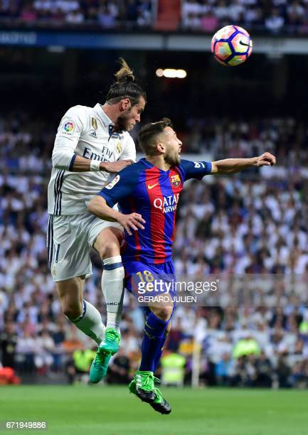 Real Madrid's Welsh forward Gareth Bale vies with Barcelona's defender Jordi Alba during the Spanish league football match Real Madrid CF vs FC...