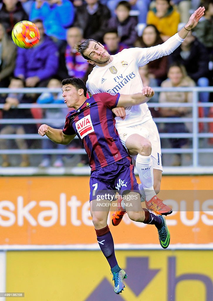 Real Madrid's Welsh forward Gareth Bale (R) vies with Eibar's midfielder Ander Capa (L) during the Spanish league football match SD Eibar vs Real Madrid CF at the Ipurua stadium in Eibar on November 29, 2015.