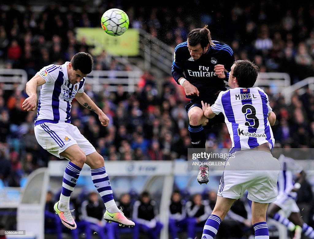Real Madrid's Welsh forward Gareth Bale vies with Real Sociedad's defender Yuri Berchiche and defender Mikel Gonzalez during the Spanish league...