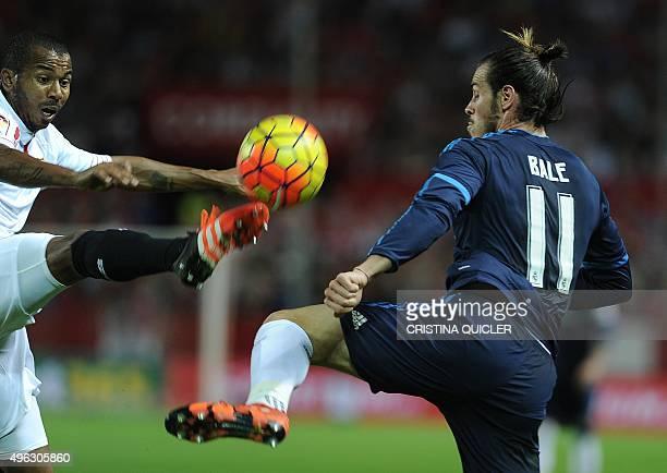 Real Madrid's Welsh forward Gareth Bale vies with Sevilla's midfielder Brazilian Mariano Ferreira during the Spanish league football match Sevilla FC...