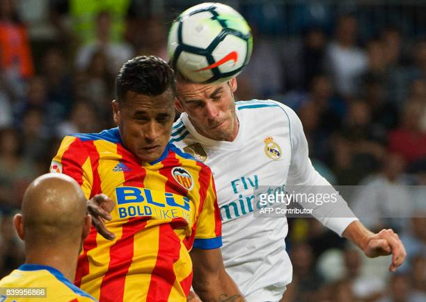 Real Madrid's Welsh forward Gareth Bale vies with Valencia's Portuguese defender Ruben Vezo during the Portuguese league football match Sporting...
