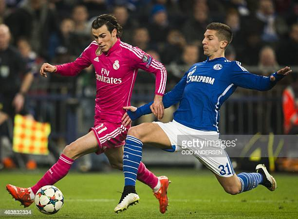Real Madrid's Welsh midfielder Gareth Bale is challenged by Schalke's Serbian defender Matija Nastasic during the firstleg round of 16 UEFA Champions...
