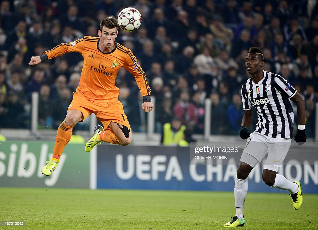 Real Madrid's Welsh striker Gareth Bale (L) jumps for the ball next to Juventus' French midfielder Paul Pogba during the UEFA Champions League Group B football match Juventus vs Real Madrid at the Juventus stadium in Turin on November 5, 2013.
