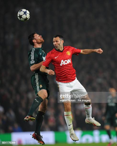 Real Madrid's Xabi Alonso and Manchester United's Ryan Giggs battle for the ball