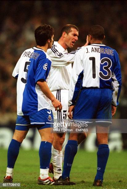 Real Madrid's Zinedine Zidane argues with FC Porto's Carlos Paredes and Jorge Andrade