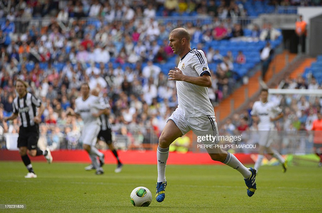 Real Madrid's Zinedine Zidane drives the ball during the Corazon Classic Match 2013 - Veracruz charity football match Real Madrid Legends vs Juventus Turin Veterans at the Santiago Bernabeu stadium in Madrid on June 9, 2013.