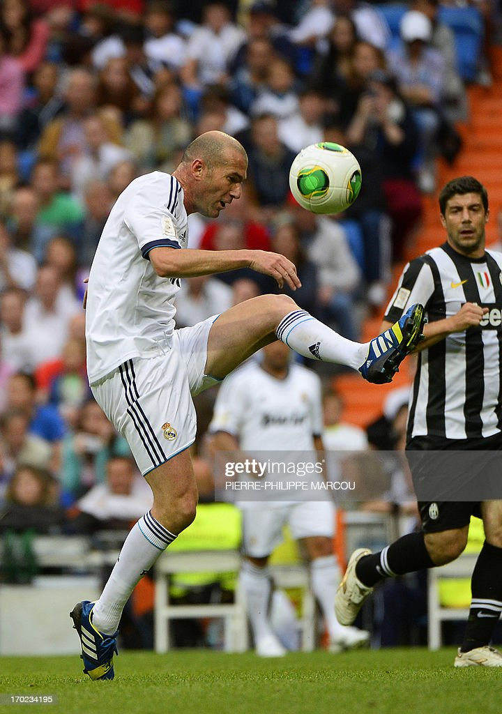 Real Madrid's Zinedine Zidane kicks the ball during the Corazon Classic Match 2013 - Veracruz charity football match Real Madrid Legends vs Juventus Turin Veterans at the Santiago Bernabeu stadium in Madrid on June 9, 2013.