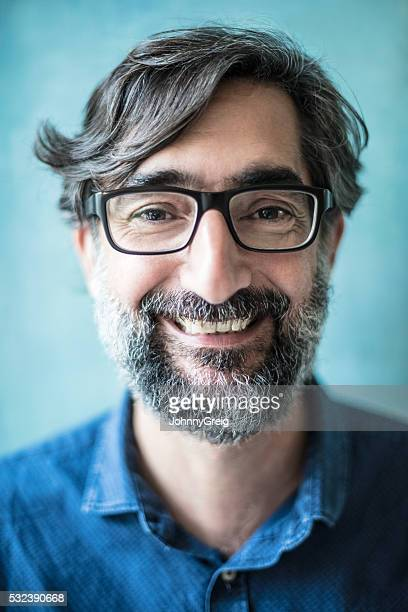 Real mature man smiling with beard, close up headshot portrait